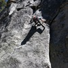 Casey just getting into the crux of the climb! delicate feet with a small horizontal crack for your hands!