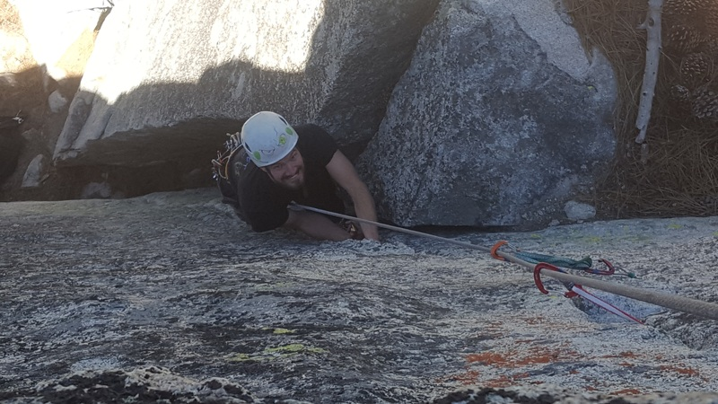 Coming out of the chimney up to the last big ledge! This is the best jamming of the route in my opinion!
