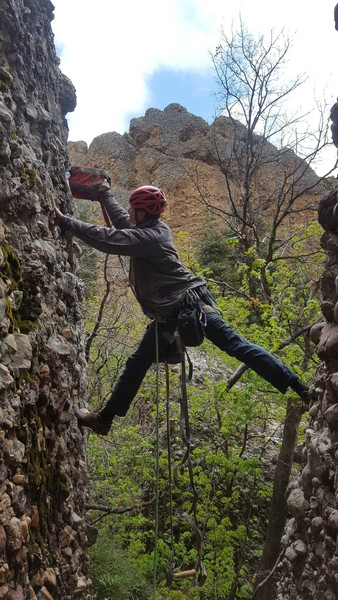 A precarious stem in a light rain while drilling the first bolt of Who Many So Manys 5.5 at Cragganzenden.