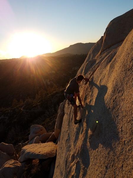 Chris climbing into the sunset