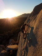 Chris climbing into the sunset