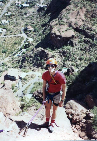 Ed rappelling from the top of the Praying Monk, you can see the old chain anchor, long since pilfered, about 1980,