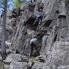 Unknown climber starting second section (from 1st belay station)<br> <br> Grimpeur inconnu qui commence la deuxième section (à partir du permier relais)