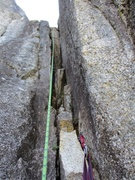 Rock Climbing Photo: The short 5.8 chimney of Pitch 6. This can easily ...