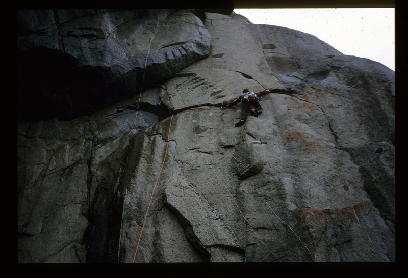 Nic Deka leading Beaman's Route (22, 11a) around 1988. Sweet Revenge (22, 11a) is the flake above. Even with double ropes it's easy to get rope drag here. The crux is the steep underhands crack above, unless you have very very small hands!