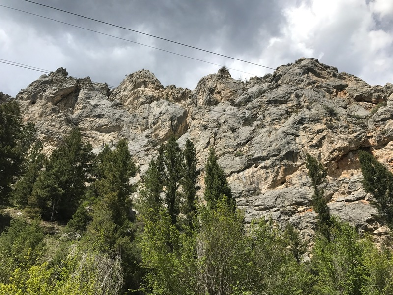 Powerline buttress from directly below on road.