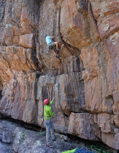 Scott moving into the flaring wide crack on the first ascent. Bob on belay.