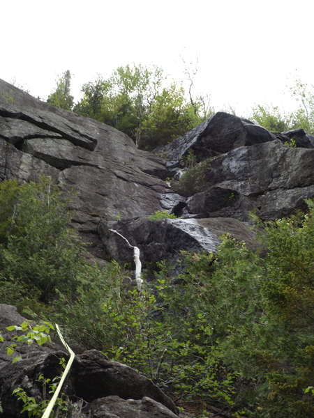Looking up at pitch 5, (after the forest scramble), the central wet streak is the chimney and is frequently wet. White central tree at top is close to the rap rings for decent.