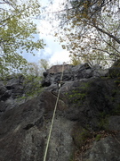 Rock Climbing Photo: Climber approaching the top of route, served by th...