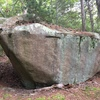 Side of the boulder directly facing the trail