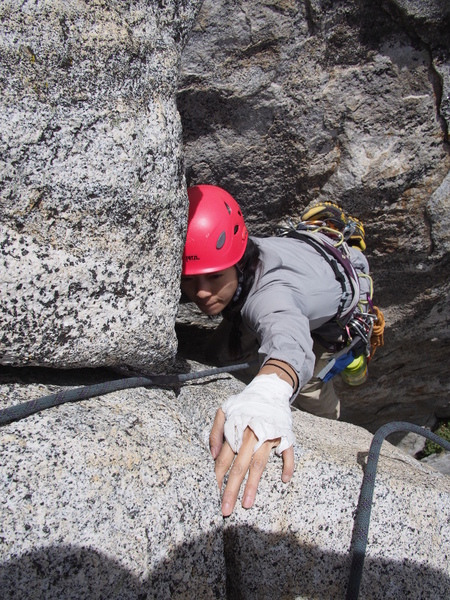 coming up the P1 chimney from the alternate, higher belay.
