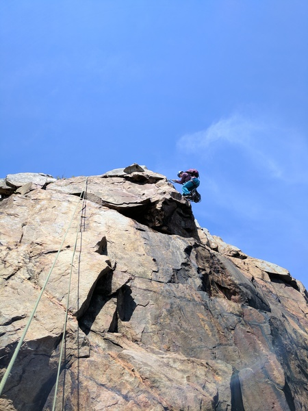 Climber about to rappel down over Crustacean to check if we set up the anchor in the right place.