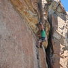 Random climber clipping before heading up the roof on Don't Take It For Granite