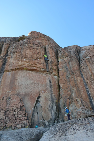 Past the roof, heading up the shallow chimney on Don't Take It For Granite