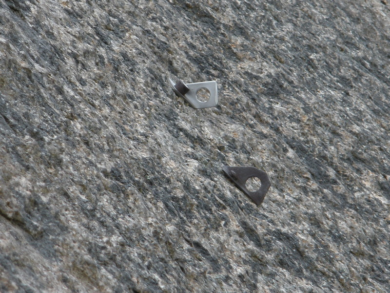 The lower pair of bolts on the Last Wave