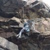 Climber working low crux of 'Winward Roof' RE-directional CAM visible (BD 0.3?)