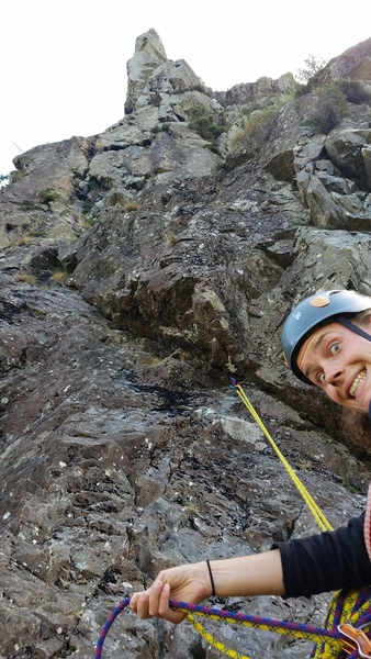 "Jo getting excited for the ""steep crack"" of pitch 3. This is from an awkward belay spot ~5 m below the proper pitch 2 belay."