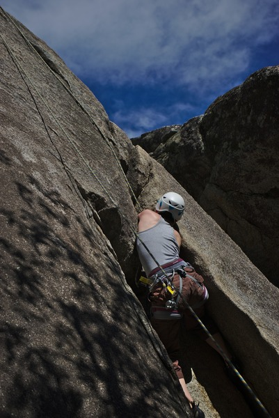 Pulling the crux. Moving out of the Amazing Chimney to the hand crack above.