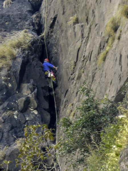 Kaivalya seconding - Wriggling on pitch one through the chimney