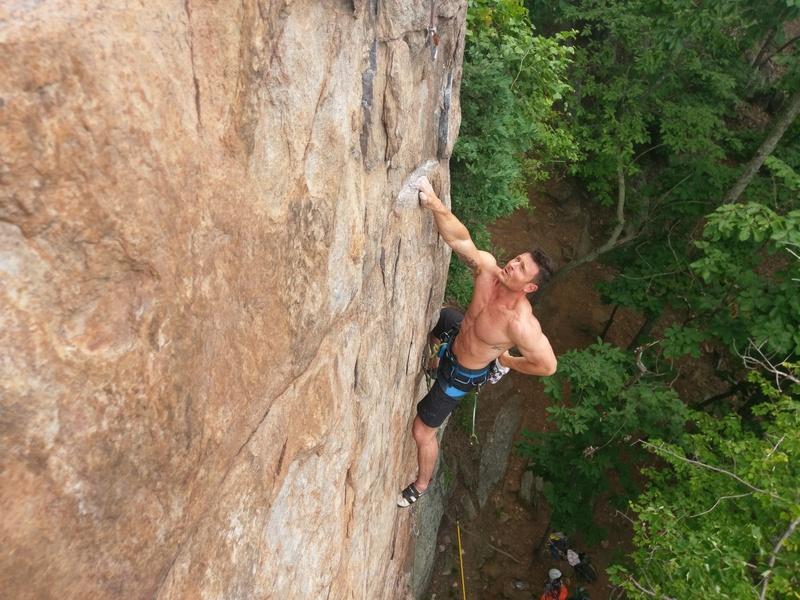 Aaron Hunter chalking up on (The Gimp) 5.10C