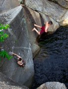 Rock Climbing Photo: A child in flight over a climber about to enter th...