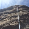 Practicing lead while on a top rope belay. This photo shows where the bolts and anchors are located.