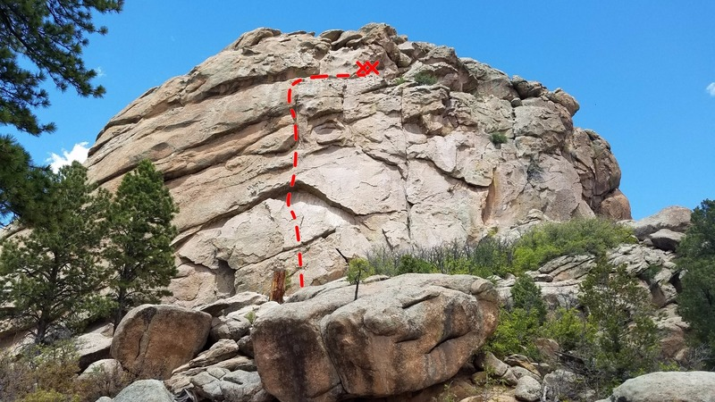 Start at the bottom of the big detached block. Climb up a crack past a bush. Finish the climb by scrambling right along ledge and then use bolts to the left of Eagle's Nest to rappel.