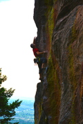 Mike McKinnon sending The Shaft just past crux move. Beautiful rock.