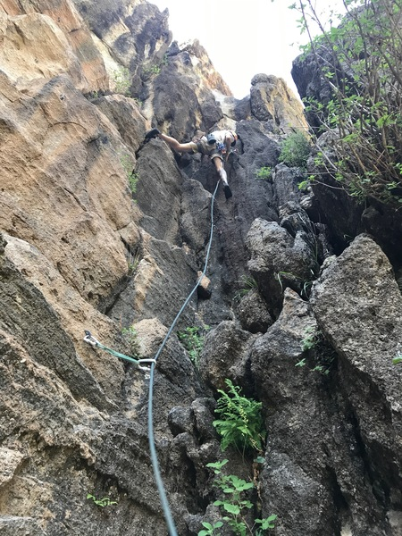 Photo of me moving up the fun corner route, photo by Mike Siddall