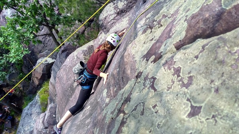 "Stacy Anderson doing ""The Step"" on her very first outdoor climb! Photo by Jesse Dukes"