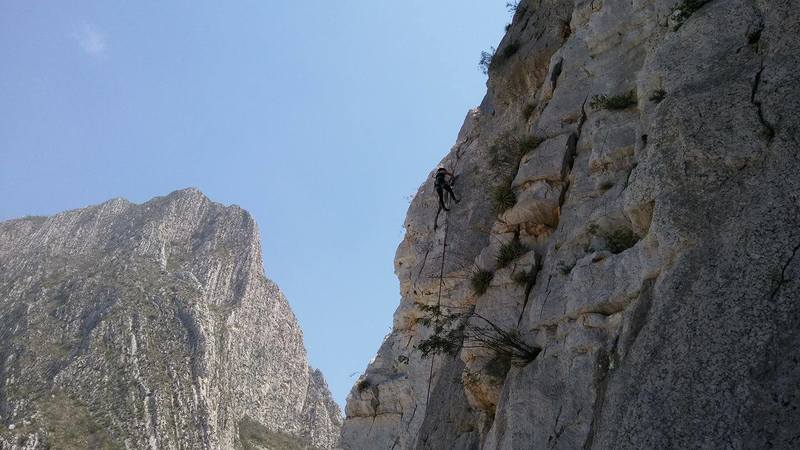 Elizabeth Rubio cleaning the route at the top