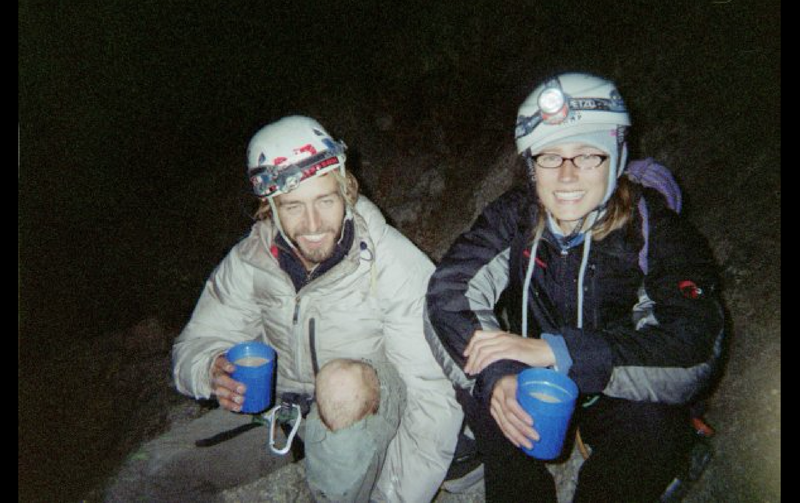 """Pat Kingsbury and Jessica Kilroy drinking victory coffee from Frank after completing the FA of the last few pitches of Frank's 1989 route, """"Blotter is my Spotter"""", Devils Tower, WY. Photo: Frank Sanders"""