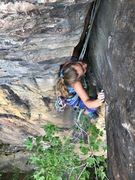 Olivia sizing up the crux on a possible variation of Up to Disneyland.