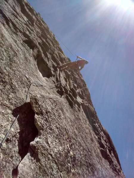 Cleaning on rappel. Beware! There is a lot for the rope to get hung up on, and the rock is quite sharp.