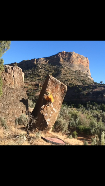 Start with right hand on a long sloping crimp, left hand on the arete. Move up the arete using holds on the face to an airy and simple topout.