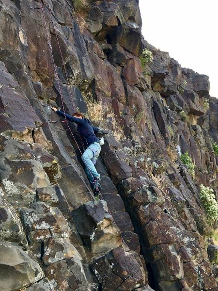 Charity Watson enjoying the easy low angle climbing of Nash-E-Mun.