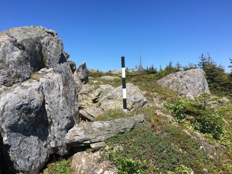 Turn left off of the East Coast Trail at this marker.  Skirt to the left of the small pond along the rock, towards the second pond