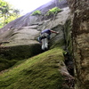 """S Matz at the 5.6 crux of """"Somebody's Got to Do It"""" [although rock looks mossy, holds are adequately brushed]"""