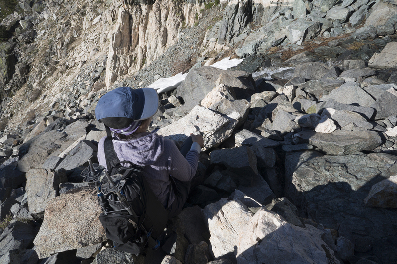 Sara Susca in the scree of the approach gully.