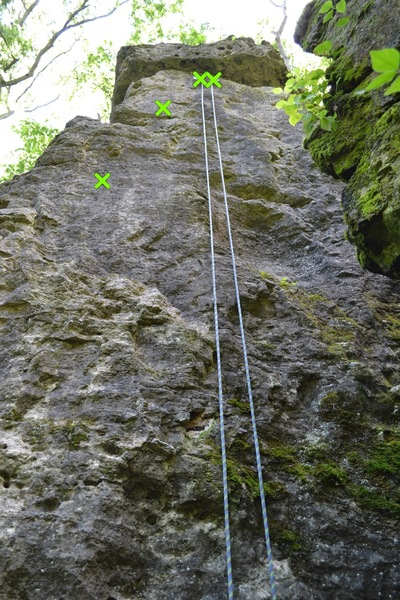Photo showing the main face of the right arete climb and its bolts/ anchors
