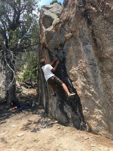 A fun V4 problem immediately on the right side of the trail, a little ways past the highball.