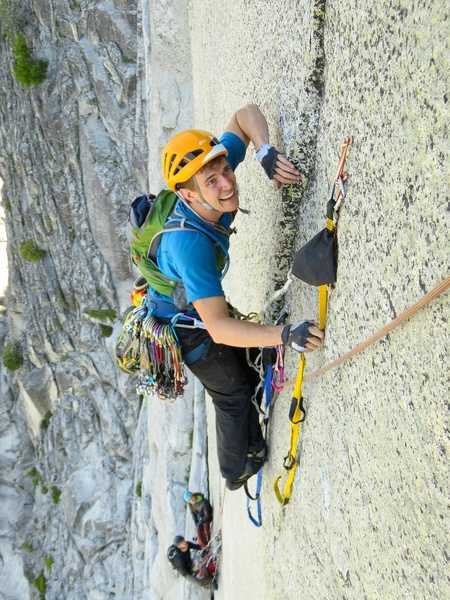 (Pitch 12 after Rockfall.) One of the bolts was missing a hanger (June 2017). This photo shows a climber (Alister) tying a sling on the bolt for protection.