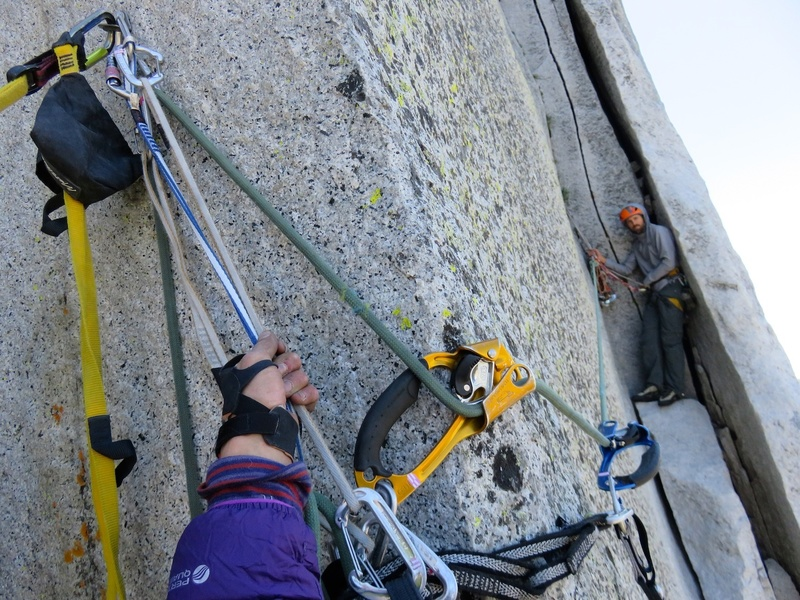 (Pitch 12 after Rockfall.) In this photo, I am at a bolt in the C2 (11c) corner, looking over at my partner Sam at the belay at the end of the pith. It is from this bolt that the leader does a rope toss to the crack where Sam's right foot is in the photo, and then ascends this rope to the belay.