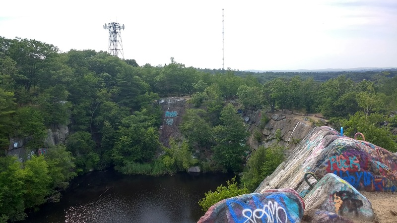 View of the little granite Rail Quarry from the top of wall F.