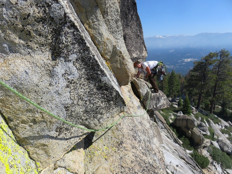 There are a few ways to surmount the summit block: a 5.10 offwidth around left (guidebook said it was around right which is a typo), a 5.10 on the prow, and a 5.6 around to the right. The prow looked a bit hard to protect, so we went around right, looking for the offwidth. Not finding the offwidth (since it was actually around left), we went up the 5.6 crack.