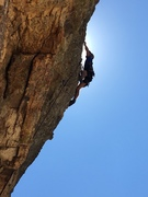 Iain Macdonald pulling the final moves on Raycreation (5.11a).
