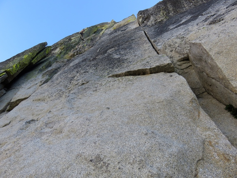 There are two ways to do the first pitch of The Howling: either the crack system on the left that the climber is rappelling in the photo or the splitter on the right.