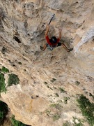 Rock Climbing Photo: Jorge Lassus clipping after the arete crux.