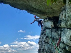 final pitch traversing under the roof to belay ledge