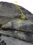 La Cruz de la Norte Direct (10b) over the boulder. Cruz (9) starts off to the left